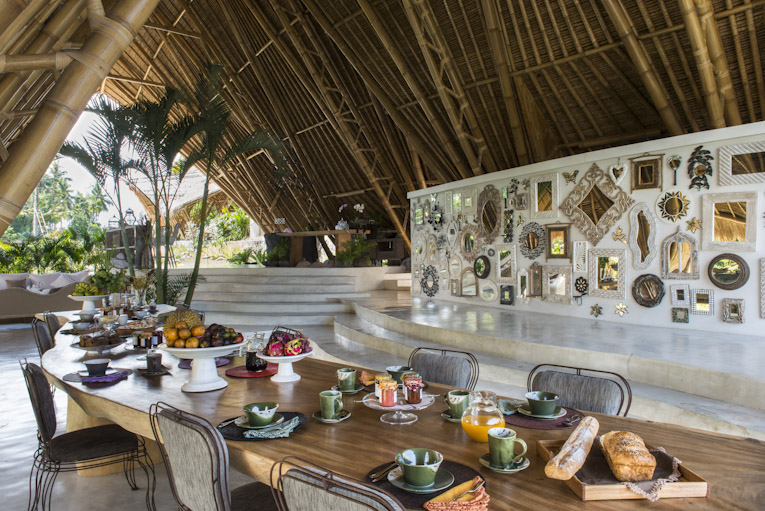 Set table for breakfast in the open living room at Sandat Glamping tents,Ubud